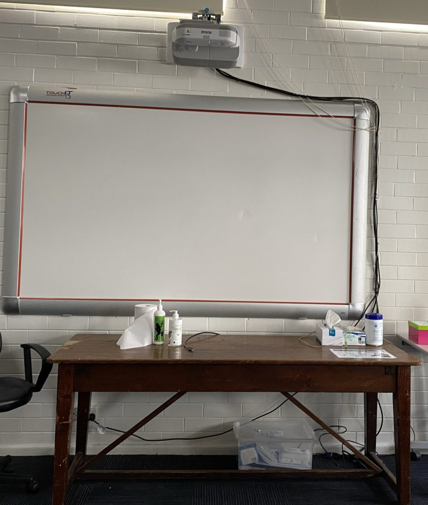 Photo of multimedia presentation screen and projector